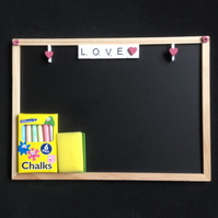 Scrabble blackboard saying love, with hand painted wooden hearts.