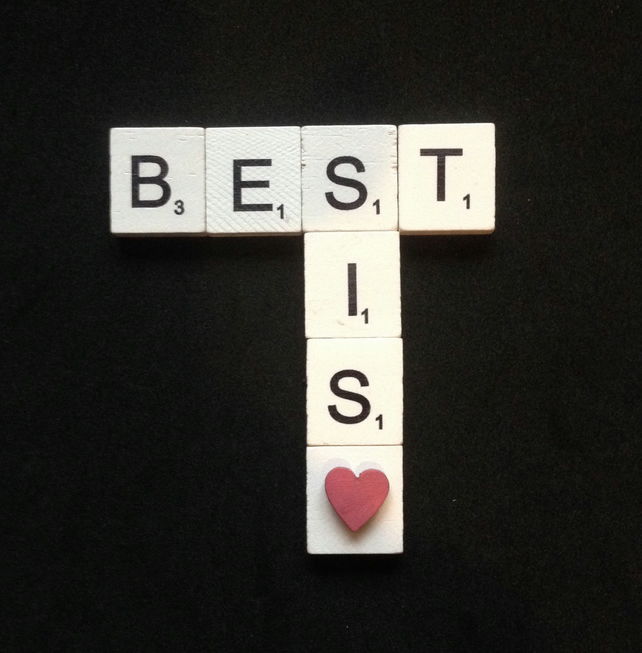 "Scrabble magnet. Wooden scrabble letters saying ""Best sis"" with a wooden heart."