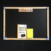 "Blackboard saying ""Home"" in scrabble letters, with wooden details."