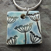 Handmade Ceramic Cow Parsley pendant in turquoise and blue