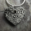 Heart shaped ceramic pendant in black white and grey