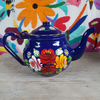 Small, hand-painted, blue enamel teapot with rose and daisy design