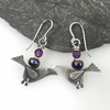Silver bird earrings with amethyst and black pearl.