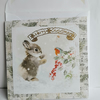 Handmade Christmas card with bunny rabbit and robin on the front