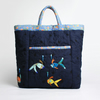 Navy blue bag with front pocket and four hand stitched fish