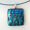 Dichroic purple green textured pendant