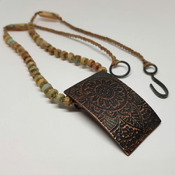 Serpentine and copper macramé pendant.