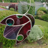 Stained glass ruby red ladybird suncatcher hanging decoration.