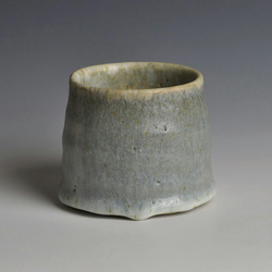 "A small, stoneware bowl with ""grey ice"" glaze"
