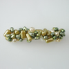 Green, cream and gold pearl hairclip