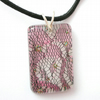 Pink and black lace scrap in resin pendant