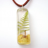 Pressed real buttercup in resin and sterling silver pendant
