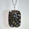 Black millefiori and sterling silver pendant
