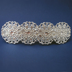 Filigree silver coloured hair clip