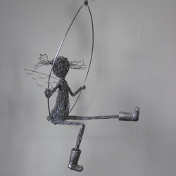 Wire fairy on a swing