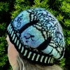 Ladies beanie, hand knitted with Fairisle pattern detail.
