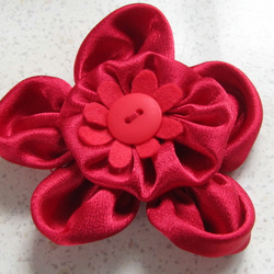 Red satin corsage