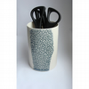 Ceramic pen pot with a row of black / grey texture