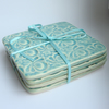 Set of four green ceramic textured coasters