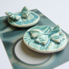 Two green porcelain butterfly magnets
