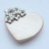 One ceramic heart magnet with  flowers