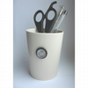 Button pen pot with black and white buttons in layers