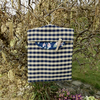 Peg bag in navy and beige check with floral lining clothes pins