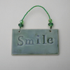 Smile...A little ceramic wall hanging