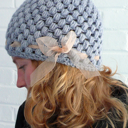 Grey wooly hat with ribbon