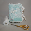 Patchwork and lace hand-stitched needle book