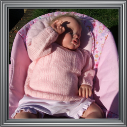 **Pay it forward**Hand knitted baby jumper in pink