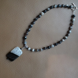 Black and brown laced necklace with black and white agate pendant
