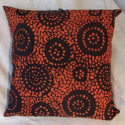 Black and orange silk cushion