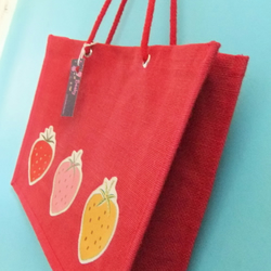 Red strawberry jute bag
