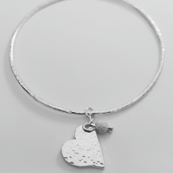 Sterling silver bangle with heart and bead charm