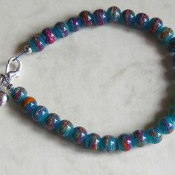 green purple and orange draw bench glass bead bracelet
