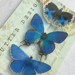 Trio of gorgeous blue silk butterfly hair clips with Swarovski Crystals.