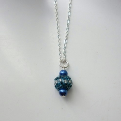 Bead woven spinning top necklace