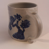 Beer mug in stoneware, with hand painted cobalt decoration. Pine trees..