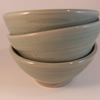 Breakfast bowl. In white stoneware clay. With celadon green glaze.
