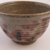 Tea bowl  (chawan). Celadon green and white  glaze with copper oxide decoration.