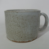 Small coffee cup, glazed in speckled white..