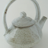 Teapot.  With white speckled glaze.  Stoneware, pottery, ceramics.