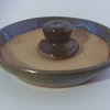 Large mortar and pestle with blue beige glaze.