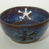 Yarn bowl for knitting, crochet, with star shaped slots. Glazed in blue beige.
