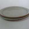 Hand thrown side plate with raised side. Glazed in speckled white. 19 cm.