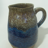 Stoneware jug with speckled white and blue beige glaze.