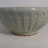 Fluted breakfast bowl. With speckled white glaze. Ceramics stoneware pottery