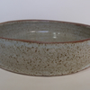 Shallow bowl. Glazed in speckled white. Ceramics stoneware pottery