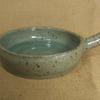 Rustic stoneware baking dish. With celadon green glaze.